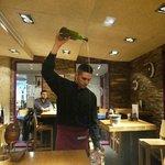 The waiter serving Spanish cider