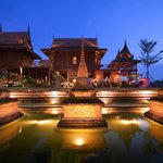 Chedi view with beautiful Thai Residence as backdrop