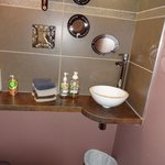 Guest bathroom at the ground level with a sweet love of detail!