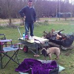 Our camping area with makeshift table and fire