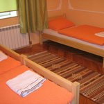 Orange room 3 single beds