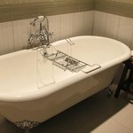 Wonderful claw foot tub -the rack is to rest your book upon as you soak...ah!
