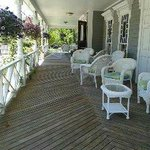 Lovely front porch to sit, relax and people watch