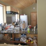 A messy but well provisioned and clean kitchen area.
