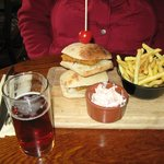 Our delicious fish sandwhich with chips, coleslaw and ale