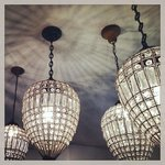 Vintage fixtures grouped in the dining area for drama