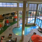 View from elevator of indoor lobby pool