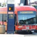The red free PASSPORT bus double-runs through Downtown Long Beach.
