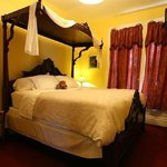 Yellow Room with king bed.  Bathroom with whirlpool tub/shower.