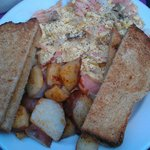 Scrambled eggs with salmon, potatoes and wheat toast