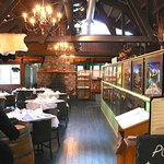 The main dining area has gorgeous photos and a real fireplace with views of the mountains