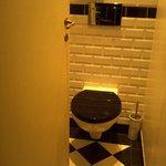 Room 3 toilet door as far at it opens