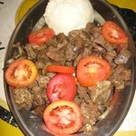 Fried Goat, tomatoes, and Ugali (flour and water).