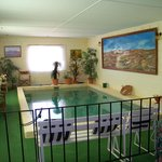 Pool room with pool table opposite