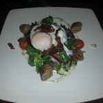 black pudding starter with toulouse sausage and poached egg.