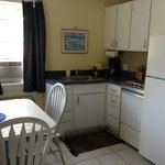 Cozy kitchen with table for two in 1-BR Unit #102