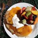 Pancakes with fresh peach compote and creme fraiche