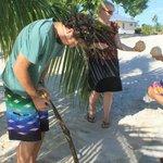 Husking fresh coconuts!