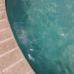 Pool surface of water too dirty to swim for 2 days.  Towels not replenished.