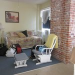 """Main room (kitchen on other side). """"Twin bed"""" is just the trundle bed/couch you see."""