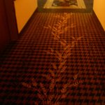 Wheat stalk pattern in the hallway carpet.