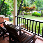 The private terrace is surrounded by a variety of tropical plants.