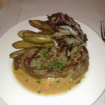 New York steak with gorgonzola cheese sauce, fingerling potatoes, and grilled radicchio