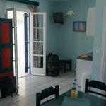 Corner with kitchenette & TV & balcony door