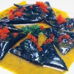 squid ink murcielagos topped with caviar