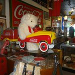 Teddy taking a ride in his Coca Cola car