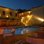 The Hotel & Pool By Night