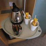 tea/coffee making with nice mugs!   fridge under this