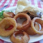 Steak and cheese sandwich with onion rings