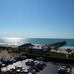 View of the pier, beach, and restaurant from room