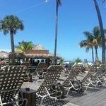 Wooden deck, sun chais and Tiki bar