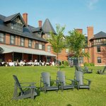 Inn patio dining and expansive lawns overlooking Lake Champlain
