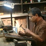 Craftsman working a copper plate