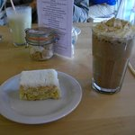 Lemon and coconut cake and a chocolate milkshake
