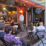People enjoy the beautiful evenings in Mount Dora with some live music and great food and drinks