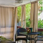 Book a massage in your own private curtained porch