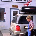 Owner Sandy Downs pumping gas at the Fields Station