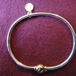 The original Cape Cod Screwball bracelet—silver with one gold ball