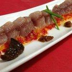 Lomos de sardina con piperrada y tomate seco