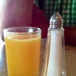 tiny little orange juice served as the only beverage with breakfast