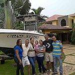 Posing by Casa Dorado boat along with Roberto