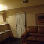Living room and part of kitchen... shows adjoining door for unit B