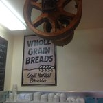 Nice sign and old mill wheels for decoration