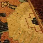 Filthy rug. Highly stained, crusted on dirt & not vacuumed.