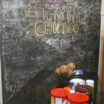 Chalkboard in the kitchen area (notice the free coffee and tea laid out)