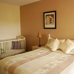 bedroom with cot for baby